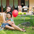 Mother, two kids and the balloon — Stock Photo