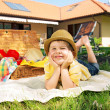 Glad little boy in the garden — Stock Photo