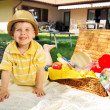 Little kid and the basket full of toys — Stock Photo