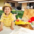 Little kid and the basket full of toys — Stock Photo #27331027
