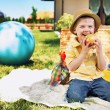 Charming boy eating huge apple — Stock Photo #27331385