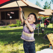 Young boy with big umbrella — Stok fotoğraf