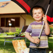 Image of a little boy with a big umbrella — Stock Photo