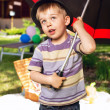 Curious boy with big umbrella — Stock Photo