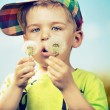 Small cute boy playing blow-balls — Stock Photo