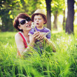 Colorful photo of mother and kid playing blow-balls — Foto Stock