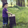 Little man leaving home with huge luggage — Stock Photo