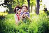 Colorful photo of mother and kid playing blow-balls — Stock Photo