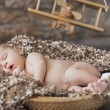 Fine picture of baby sleeping in toy room — Stock Photo