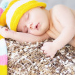 Picture of sleeping baby with woollen cap — Zdjęcie stockowe