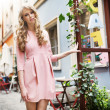 Tall and pretty young model walking in old town — Stock Photo #27753837
