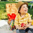 Smiling chlid holding juicy apple — Stock Photo