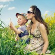 Family having a lot of fun with dandelions — Stock Photo