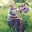 Cheerful family playing on tall grass — Stock Photo