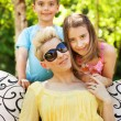 Pleased family resting in the garden — Stock Photo