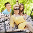 Happy family relaxing during sunny vacations — Stockfoto