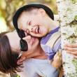 Laughing small boy hugged by his mother — Stock Photo #27758467