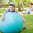 Little gentleman playing a big ball — Stock Photo