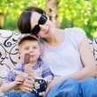 Pleased mother relaxing with her son — Stock Photo
