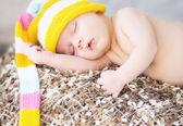 Picture of sleeping baby with woollen cap — Stock Photo