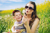 Attractive mother playing with her lovely son — Stock Photo