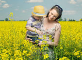 Walking among the canola flowers — Stock Photo