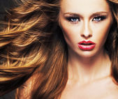 Female model with sensual lips and brown hair — Stock Photo