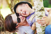 Laughing small boy hugged by his mother — Stock Photo