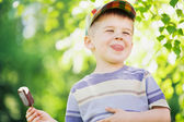 Cheerful boy eating an ice cream — Stock Photo