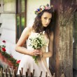 Young woman with buquet of wild flowers — Stockfoto