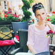 Cute woman waiting in the restaurant — Stock Photo #29752815