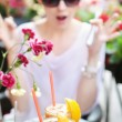Surprised brunette lady staring at glasses of juice — Stok fotoğraf
