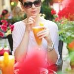 Thirsty lady drinking an orange juice — Stock Photo #29754759