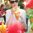 Thirsty lady drinking orange juice — Stock Photo #29754759