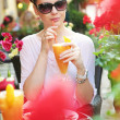 Foto Stock: Thirsty lady drinking orange juice