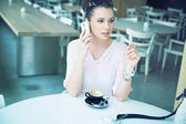 Relaxed brunette lady making a phone call — Stock Photo