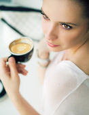 Nice brunette lady in the coffee shop — Stock Photo