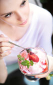 Delicate alluring lady with dessert — Stock Photo