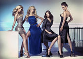 Fashion picture of four attractive female models — Stock Photo