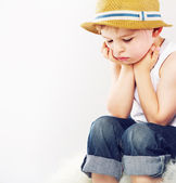 Sad boy with his straw hat — Stock Photo