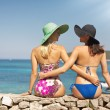 Summer shapely girls on the beach — Stock Photo
