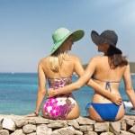 Summer shapely girls on the beach — Stock Photo