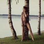 Bare feet lady staring at huge lake — Stock Photo #31813207