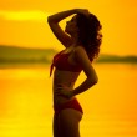 Portrait of brunette woman posing in profile — Stock Photo #31813521
