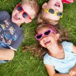 Laughing kids relaxing during summer day — Stok fotoğraf