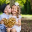 Great portrait of two kissing kids — Stock Photo