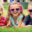 Funny picture of three playing kids — Stock Photo