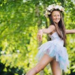 Fine photo of young girl wearing flowers — Stock Photo
