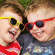 Smiling brothers wearing fancy sunglasses — Stock Photo