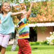 Cheerful kids chasing soap bubbles — Stock Photo #31816603